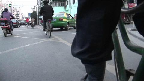 A POV shot of a man pedaling a rickshaw through the... Stock Video Footage