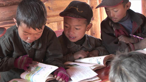 Chinese children study hard at a rural school Stock Video Footage