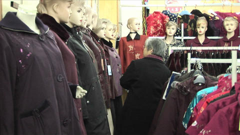 A woman shops in a clothing store with many mannequins Stock Video Footage