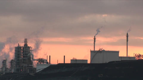 A time lapse shot from day to night of a petrochemical... Stock Video Footage