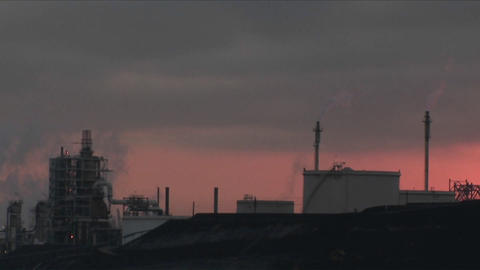 A time lapse shot from day to night of a petrochemical factory or oil refinery Footage
