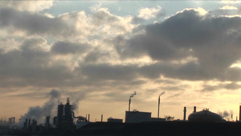 A petrochemical factory or oil refinery under a cloudy sky Footage