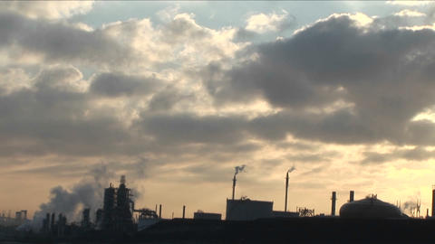 A petrochemical factory or oil refinery under a cloudy sky Stock Video Footage