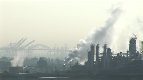 Smoke rises from a petrochemical factory or oil refinery... Stock Video Footage