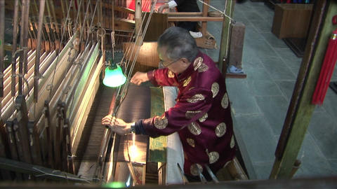 A man works in a Chinese textile factory Footage