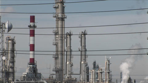 Steam rises from an oil refinery Stock Video Footage