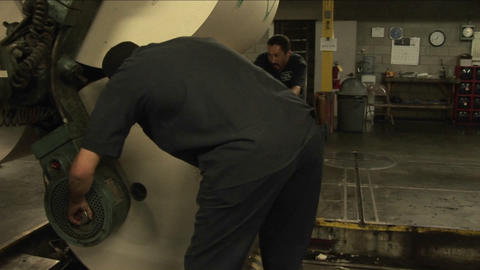Workers load newspapers at a paper factory Stock Video Footage