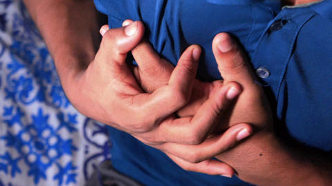 young man suffering pain in heart and holding chest with hand Live Action
