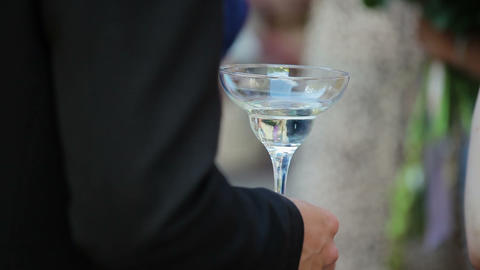 A man holding a glass of champagne Footage