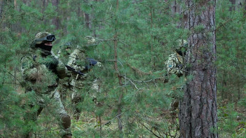 Military special forces moving in the forest Footage