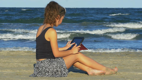 Woman chatting on social media on tablet pc by the sea Footage