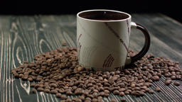 Coffee Cup and Beans on Wooden Table Footage
