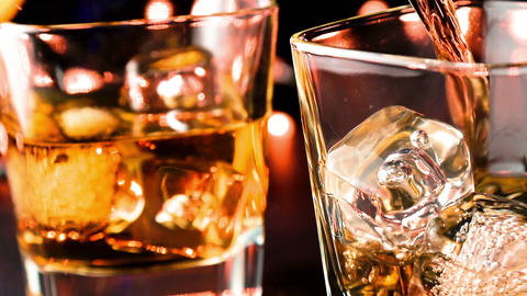 barman pouring whiskey in the glass on bar table, whisky relax time concept, relax Live Action