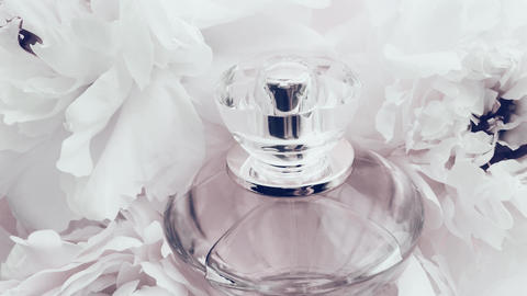 White perfume bottle with peony flowers, chic fragrance scent as luxury cosmetic Live Action
