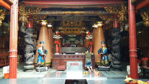 Woman praying inside Hsinchu Cheng Huang temple, Live Action