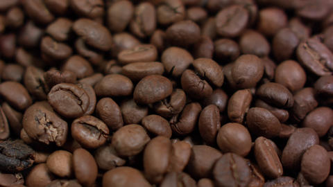 Brown background from coffee grains close up filling all space Footage