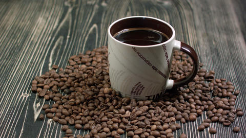 Top view of coffee cup on a wood background with copy space Footage
