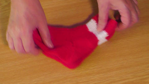 Children's wear. Children's red knitted socks Footage