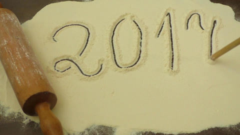 Numbers 2017 written on white flour. Preparing for new year. New year concept Footage