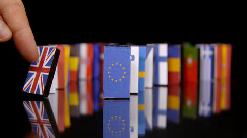 The Eu Dominos Fall. Flags of European Countries like a domino falling down Footage