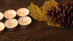 Group of burning candles on wooden background Footage