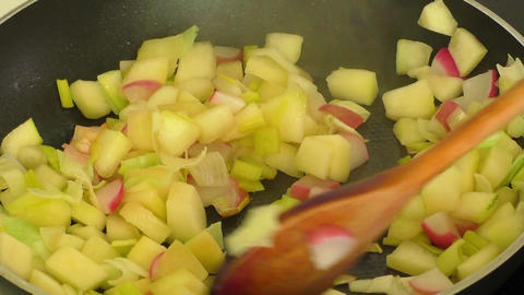 Fried vegetables on a frying pan close-up Footage