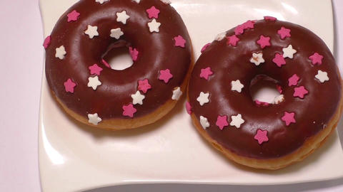 Delicious donuts with icing on plate Footage