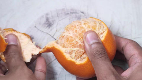 taking skin off from a orange Live Action