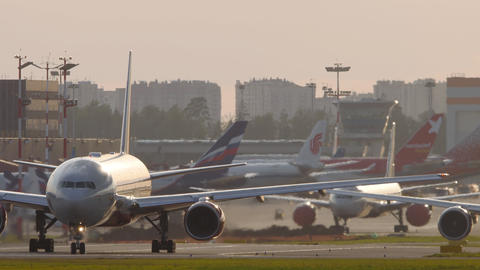 Rossiya Airlines Boeing 777 airliner taxiing to runway for departure Live Action