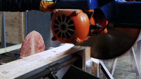 The man moves a large saw to cut a few bars GIF
