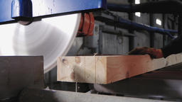 Lumber industry - Circular saw cuts the ends of wooden beams Footage