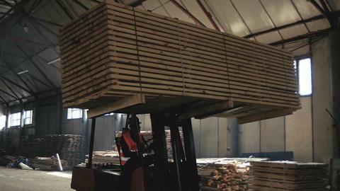 Trucks Transporting Blocks of Wood GIF