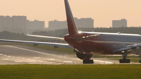 Rossiya Airlines Boeing 777 airliner lining up on the runway for departure Live Action
