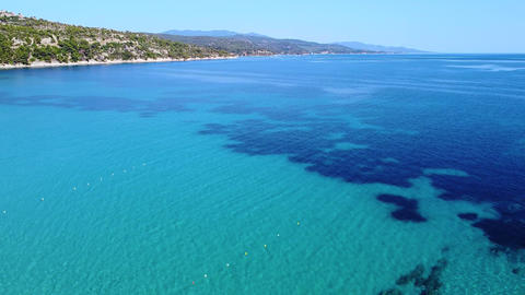 Aerial view of exotic tropic tranquil azure blue sea and coast with trees Live Action