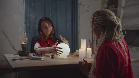 Soothsayer predicting future with crystal ball Live Action