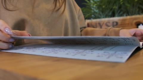 Back View of a Woman Reading a Menu in a Restaurant. Lifestyle Live Action