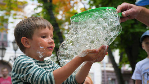 Excited Boy by Positive Emotions in Soap Bubble Show. Cheerful and Smiling Kid Live Action