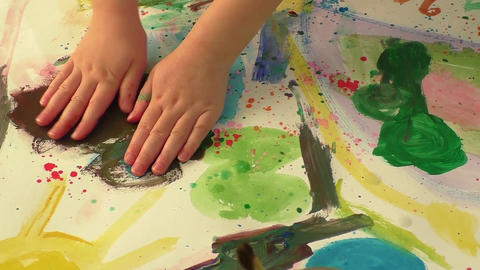Creative paint art with little hand of a young girl. Childhood and education the Image