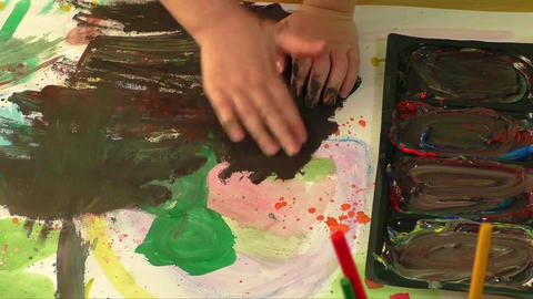 Creative paint art with little hand of a young girl. Childhood and education the Footage