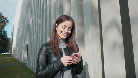 Woman Using App on Smartphone Smiling and Texting Live Action