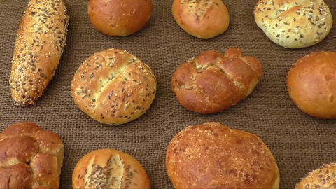 Different sorts of wholemeal breads and rolls, selective focus Footage