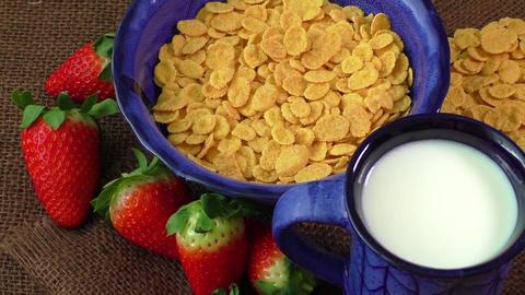 Healthy breakfast. Cornflakes, fresh strawberries and milk Footage
