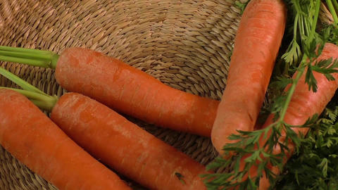 Fresh garden carrots and fresh peeled carrots Footage