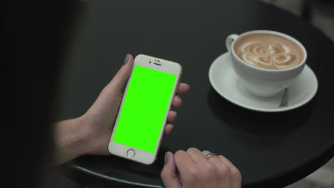 Woman Using a Mobile Phone with Green Screen Footage