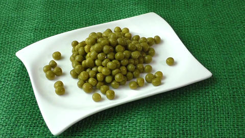 Green peas on a white plate. Healthy food Footage