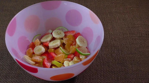 Bowl of healthy colorful fruit salad. Healthy food. Healthy breakfast Live Action