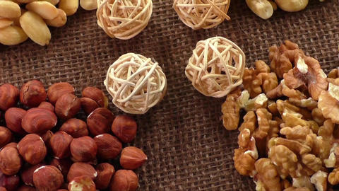 Almonds, cashew, walnuts and hazelnuts lying on burlap. Healthy food Live Action