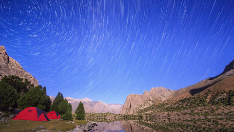 Mountains in the moonlight. Traces of stars similar to metory. Time Lapse. Pamir Footage