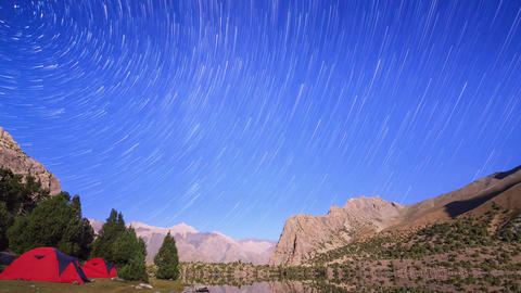 Moonlit night in the mountains. Traces of stars similar to metory. Time Lapse. P Footage