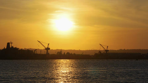 Industrial port cargo at the sunset in 4k slow motion 60fps Live Action